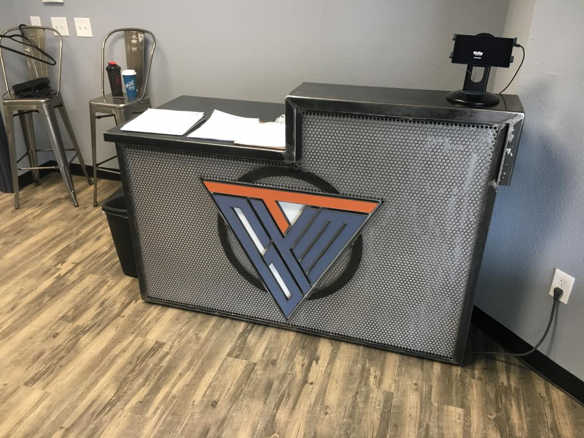 Metal Desk With Client S Logo Custom Designed To Embellish The Center